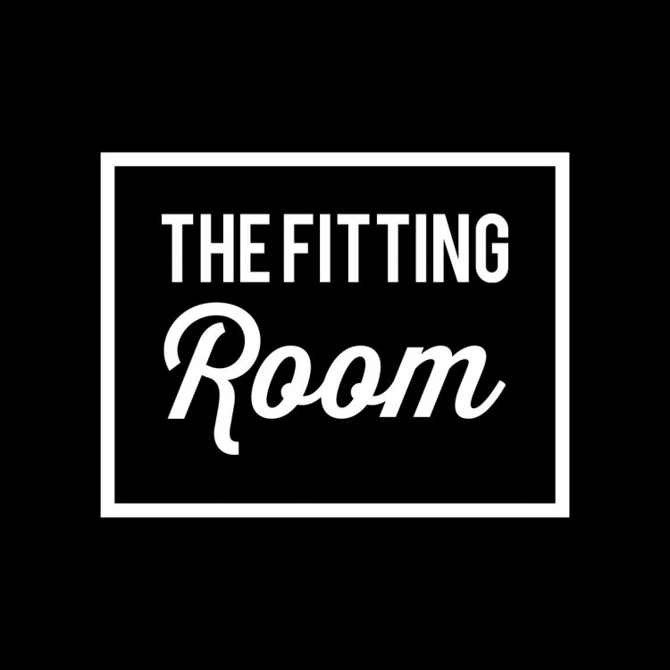 """Typographic black and white image of the words """"The Fitting Room"""" surrounded by a white box."""